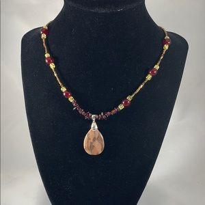Teardrop brown zebra stone pendant w/ garnet
